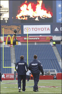 San Diego Chargers head coach Norv Turner (left) checked out the field before the game.