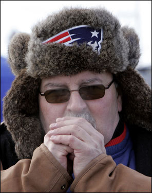 Tony Bonanno, of Topsfield, warmed his hands before the AFC Championship.