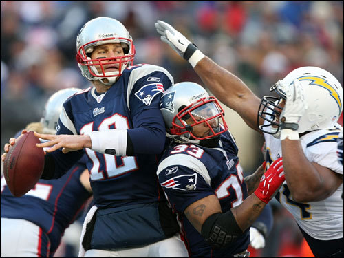 Tom Brady (left) fired a pass under pressure in the first quarter.