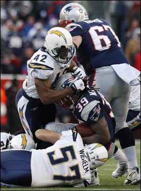 Patriots running back Laurence Maroney (39) was tackled by Chargers defenders in the first quarter.