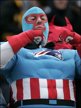 A fan pointed to the Patriots logo on his costume during the game.