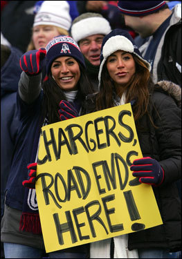Fans of the New England Patriots held up a sign which read 'Chargers Road Ends Here!'