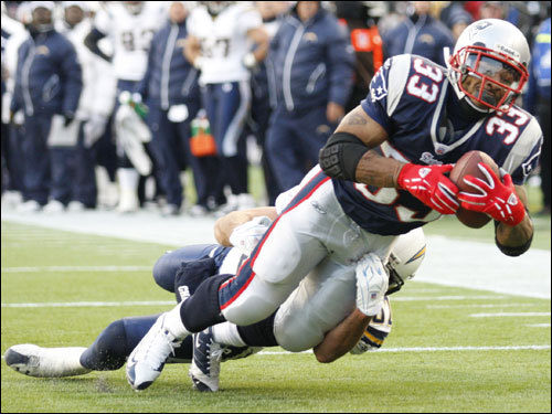 Kevin Faulk stretched toward the goalline but was forced out at the one-yard line.
