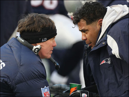 Bill Belichick (left) and Junior Seau (right) talked on the sidelines during the game.