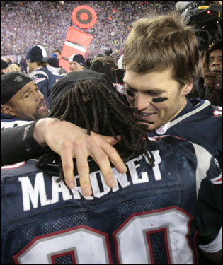 Tom Brady (right) celebrated with Laurence Maroney (39) after the game.