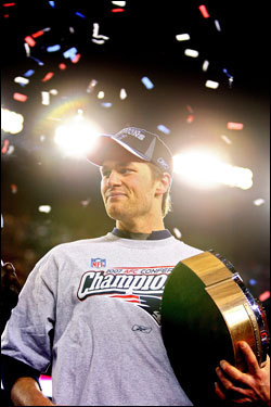 Tom Brady celebrated with the Lamar Hunt Trophy after the game.