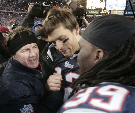 Patriots head coach Bill Belichick (left), Tom Brady (center), and Laurence Maroney (right) celebrated after the game.