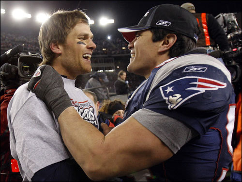 Tom Brady (left) and Tedy Bruschi (right) celebrated on the field.