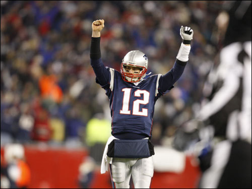 Tom Brady celebrated the final first down for the Patriots, ensuring victory in the AFC Championship game.