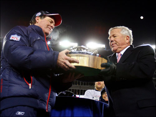 Bill Belichick (left) took the Lamar Hunt Trophy from Pats owner Bob Kraft during celebrations.