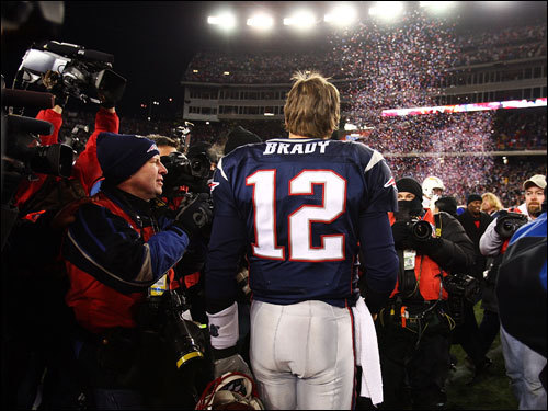 Tom Brady walked through the throngs of media on the field during celebrations.
