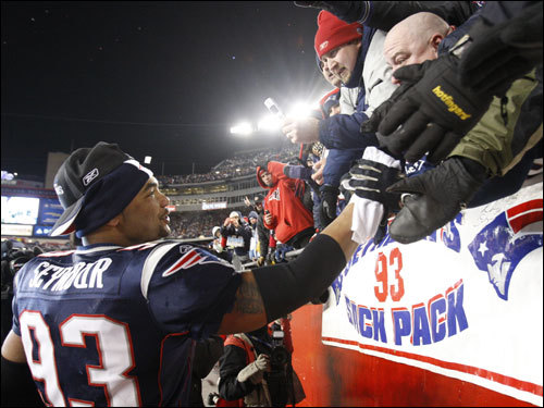 Patriots DL Richard Seymour celebrated with fans after the game.