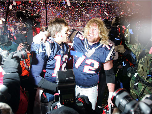 Tom Brady (left) and Matt Light (right) celebrated on the field after the game.