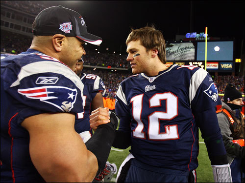 Junior Seau (left) and Tom Brady (right) celebrated on the field.