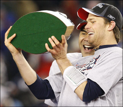 Junior Seau (rear) and Tom Brady shared a laugh on the stage during celebrations.