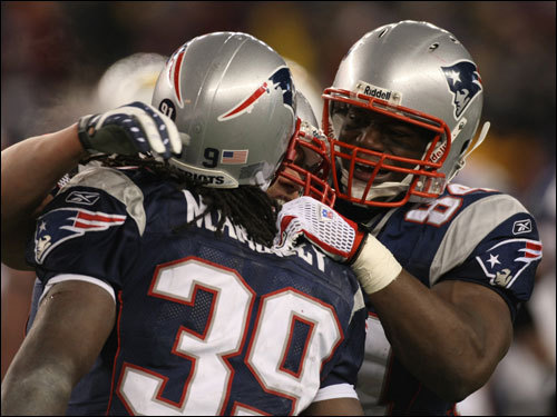 Laurence Maroney (39) and Benjamin Watson (84) celebrated the final first down for the Patriots.