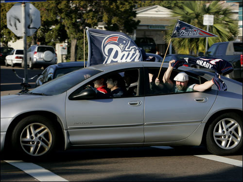 Patriots fans cheered as they drove down Garnet Avenue in the Pacific Beach section of San Diego after the AFC Championship.