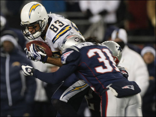 Patriots safety Brandon Meriweather (31) delivered a hit on Vincent Jackson (83) during the game.