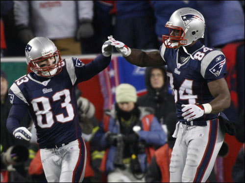 Wes Welker (left) and Benjamin Watson (right) celebrated after Welker's touchdown reception in the third quarter.
