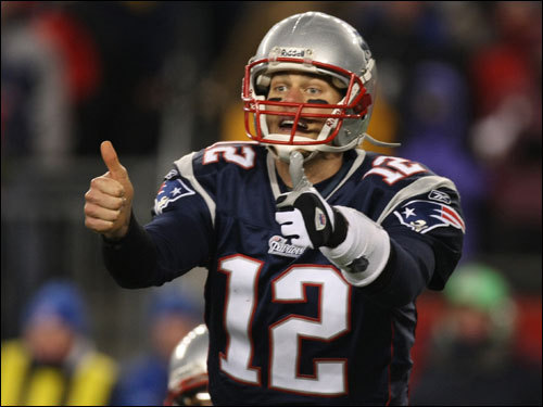 Tom Brady gave a thumbs up signal to a teammate during the game.