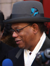 The Rev. Calvin Butts said race was not a factor in his decision.