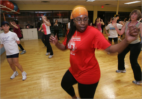 Angel Green of Lynn dances along to Latin rhythms during a Zumba class at Salem's Gold Gym.