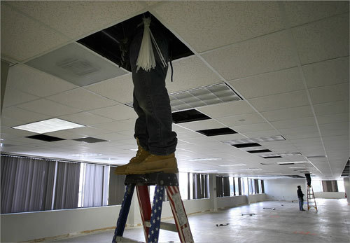 A worker entered a ceiling panel on the third floor of the new headquarters of the Archdiocese of Boston to work on the electrical wiring. The archdiocese is renovating the 140,000-square-foot building, located at 66 Brooks Dr. in Braintree.