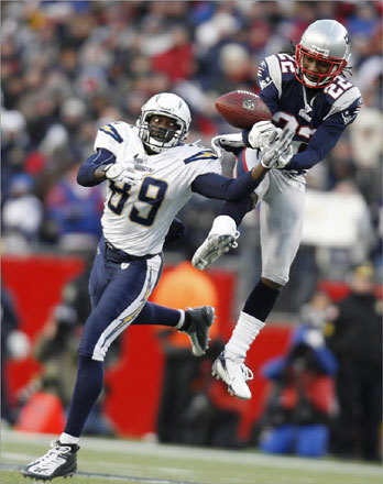 New England Patriots cornerback Asante Samuel (right) tore the ball away from San Diego Chargers wide receiver Chris Chambers en route to an interception.The Patriots went on to defeat the Chargers in the AFC Championship game on Jan. 20, solidifying their spot in Super Bowl XLII.