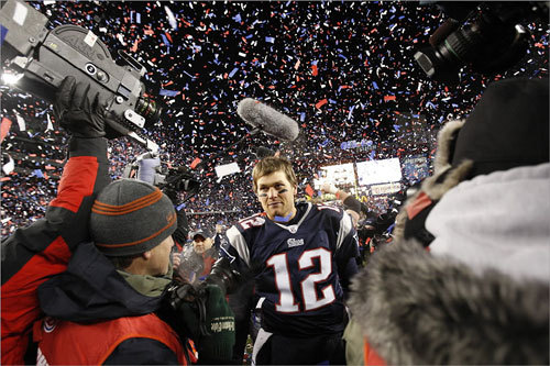 Patriots quarterback Tom Brady navigated his way through a sea of media after winning the AFC Championship game.