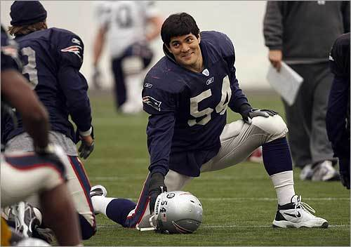 Tedy Bruschi smiled while stretching at Friday's practice session in Foxborough.
