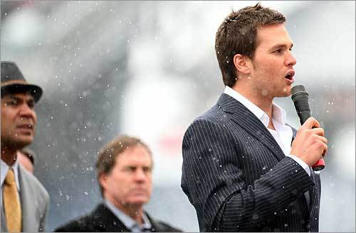 Brady (right) spoke to the fans during the New England Patriots Super Bowl send-off. Though he did not address his high ankle sprain, he was spotted walking to the team buses after the rally and did not appear to be limping.