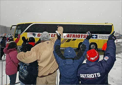 New England Patriots fans waved good-bye to their team during the Super Bowl send-off at Gillette Stadium. The Pats headed to Arizona to play in the Super Bowl.