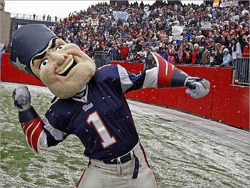 Mascot Pat Patriot threw a T-shirt into the snowy stands.