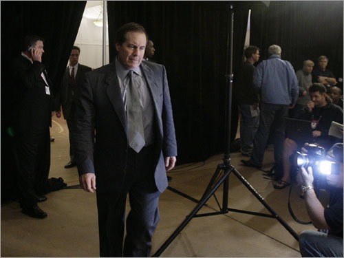 Coach Bill Belichick walked past photographers at a press conference in Arizona.