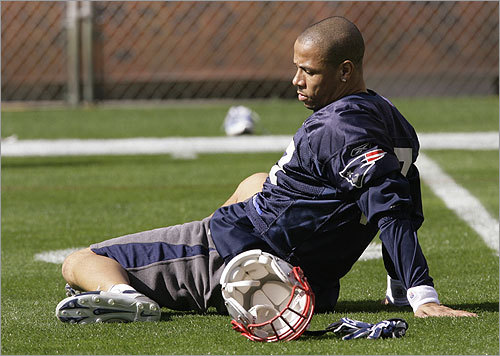 Patriots safety Rodney Harrison stretched before football practice began at Sun Devil Stadium.