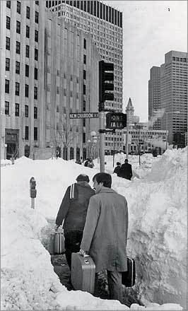 Commuters snaked between walls of snow at the corner of New Chardon and Cambridge streets, near Government Center.
