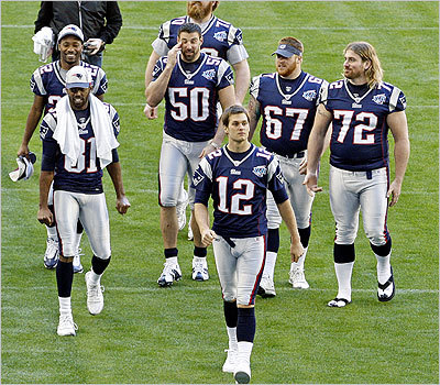 Tom Brady led the pack at Tuesday's Super Bowl Media Day. Mike Vrabel (50), Matt Light (72), Dan Koppen (67), Randy Moss (81), Asante Samuel (22), and Logan Mankins (70) followed Brady off the field at the end of the media session.