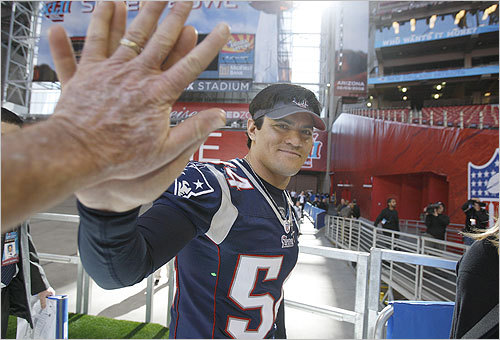 Tedy Bruschi left the field with a smile.