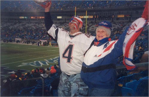 Carolyn Navarro and Jay pose at Gillette Stadium.