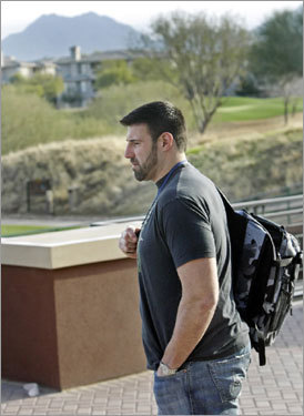 Linebacker Mike Vrabel is shown as he leaves the room after the event and heads outside.