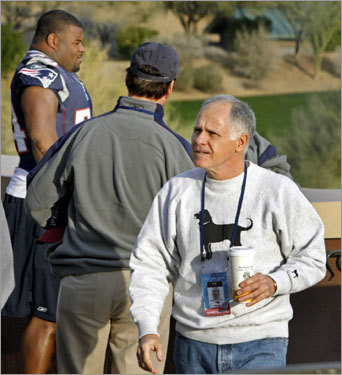 Here offensive line coach Dante Scarnecchia, coffee cup in hand, arrived for Wednesday's session.