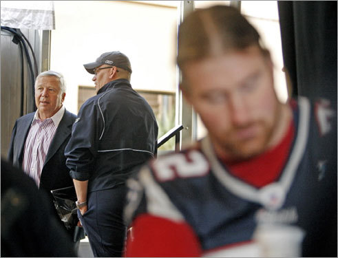 Team owner Robert Kraft (far left) was hanging out in the backround while in foreground right, offensive lineman Matt Light sat at his table and took questions from reporters.