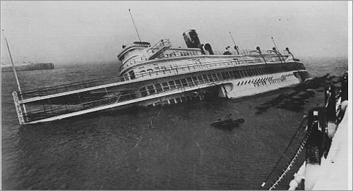 The Peter Stuyvesant -- once a famed Hudson River riverboat that was restored and made part of the Pier 4 restaurant on Boston's harbor front -- was flooded by surging tide waters and left leaning and partially submerged. The vessel later was demolished and her remains removed from the pier area.