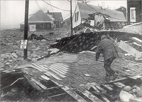 Even more extensive was the havoc raised in towns along the South Shore of Massachusetts Bay, where many homes were positioned on streets that were only a few feet above sea level. This picture was taken during the height of the storm at the entrance to Town Way at Peggotty Beach in Scituate.