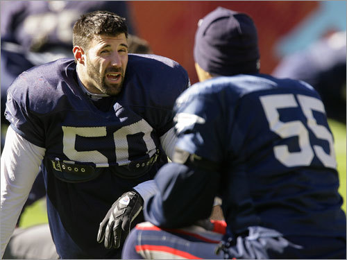 Patriots linebackers Mike Vrabel (50) and Junior Seau (55) talked as they stretched.