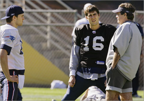 Patriots head coach Bill Belichick (right) talked with quarterbacks Tom Brady (12) and Matt Cassel (16).