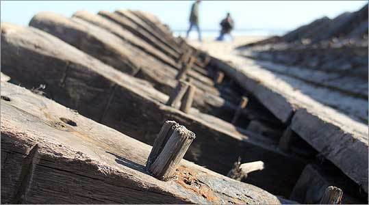 Wooden pegs lined the ribs on the remains of a 19th-century schooner that washed up onto Newcomb Hollow Beach on Cape Cod.