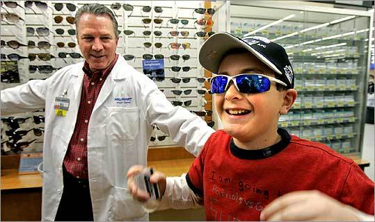 Before leaving for Arizona, 10-year-old David Youngerman shopped for sunglasses and other swell goods after Wal-Mart in Hudson gave him a $500 shopping spree. Bill Sullivan, the store's vision department manager, assisted.