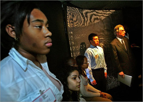 Fenway High School students listened and watched a multimedia part of the 'Choosing to Participate' exhibit at the Boston Public Library today.