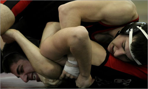 North Andover's Sal Scali (bottom) wrestled Winchester's Ryan Fitzpatrick (top) in the 130 weight class.